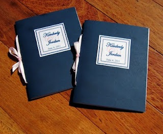 Cute orders of service - a navy blue cover, with a white inner layer for the information to be written on. The pink was included on the design on the front, and on the ribbon holiday the order of service together!
