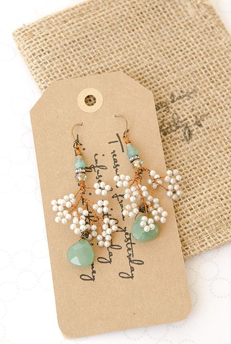 The uncertainty of a swaying sea and the calm of a gentle snow fall combine to create these Seaside Snowflake Earrings. Artwork: Kathy Jo Menasco.