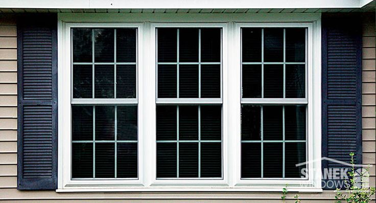 White, double-hung windows with colonial grids. Discover more.