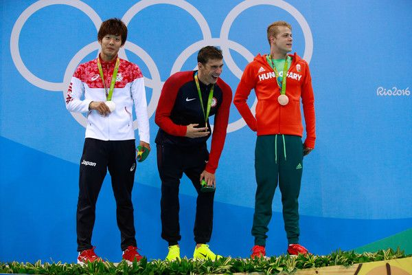 (L-R) Silver medalist Masato Sakai of Japan, gold medalist Michael Phelps of the United States and bronze medalist Tamas Kenderesi of Hungary pose on the podium during the medal ceremony for the Men's 200m Butterfly Final on Day 4 of the Rio 2016 Olympic Games at the Olympic Aquatics Stadium on August 9, 2016 in Rio de Janeiro, Brazil.