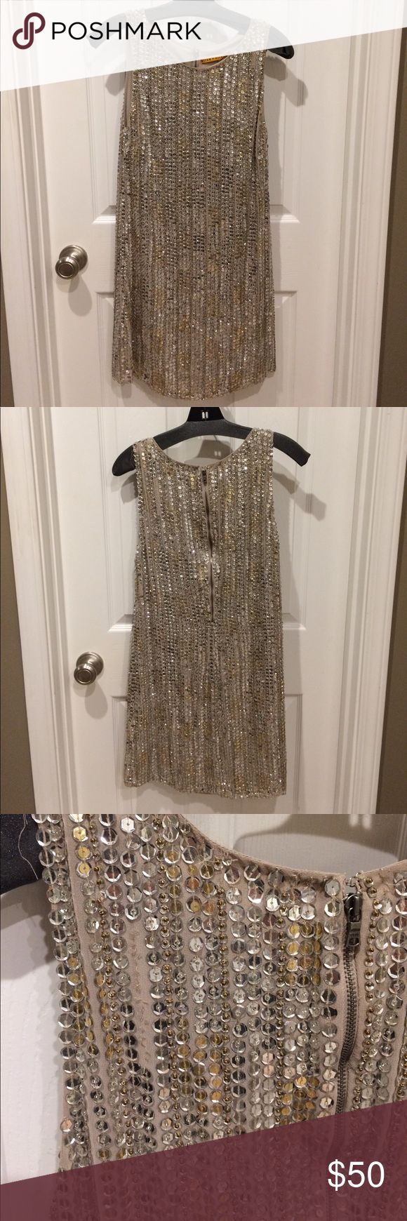 Alice + Olivia sequin cocktail dress, size 4. Alice + Olivia sequin cocktail dress, size 4.  Nude background with silver sequins & gold beads. Beautiful dress!  There are a couple of spots with sequins missing (see pics), this is reflected in the price & not noticeable when the dress is on. Alice & Olivia Dresses