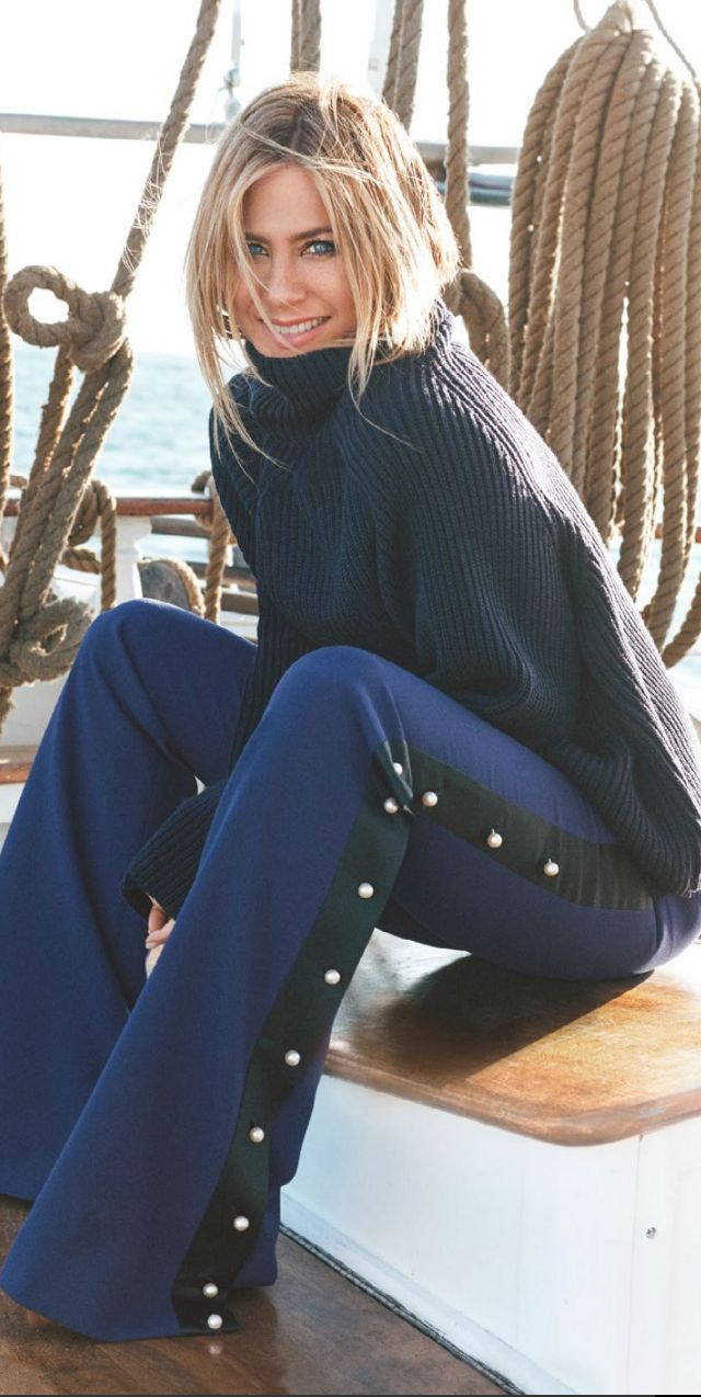 Who made  Jennifer Aniston's blue pants and black ribbed turtleneck sweater?