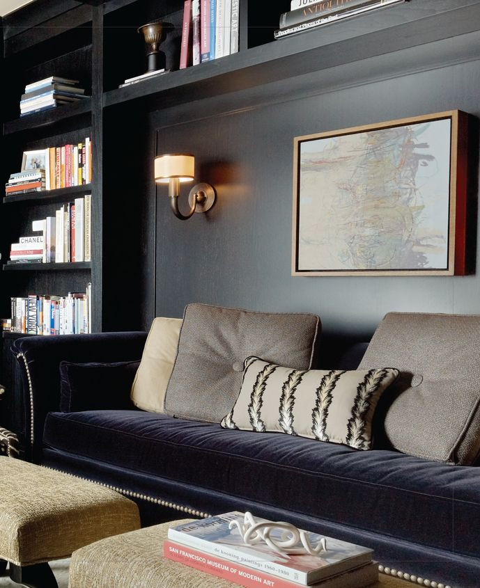 black walls, library sconce, velvet sofa, library