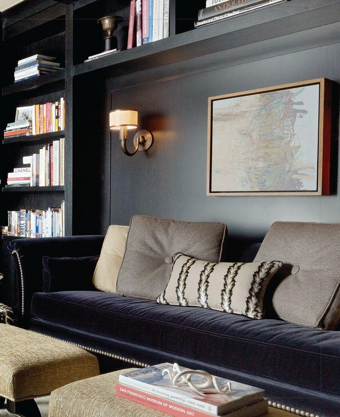 black walls, library sconce, velvet sofa, library