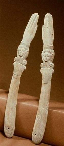 A pair of ancient Egyptian wooden clappers in the form of hands adorned w/the cow-eared image of the goddess Hathor. Rijksmuseum van Oudheden