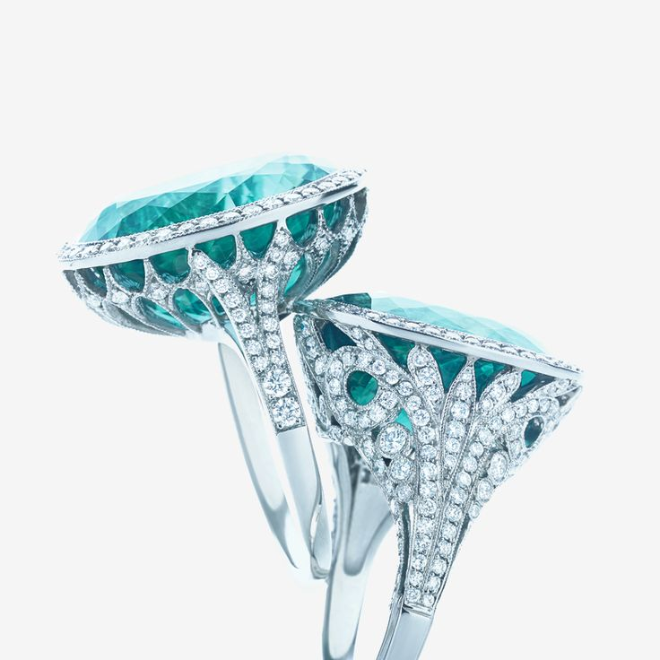The deep blue-green of tourmaline beckons the eye like a tropical sea in these diamond-encrusted rings.