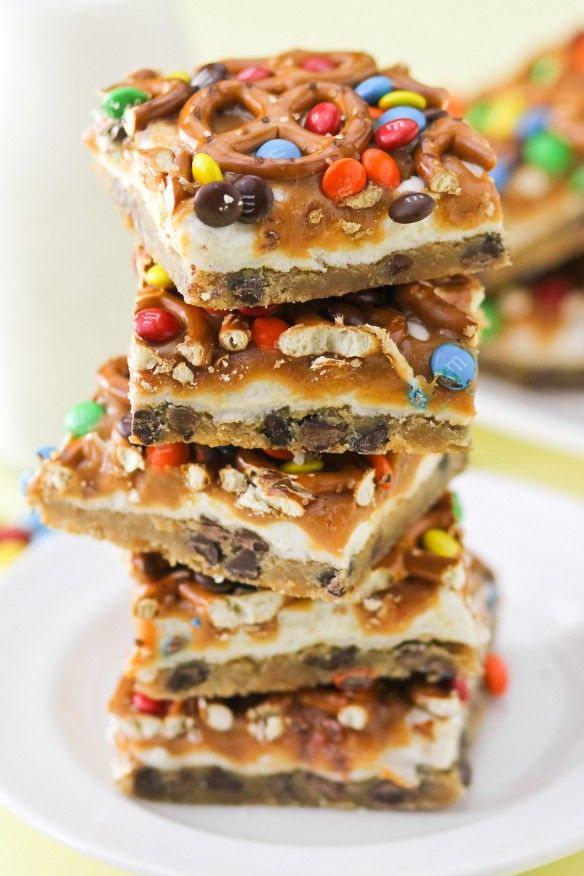 Everything Bars are my MOST POPULAR recipe for parties and potlucks! Layers of chocolate chip cookie bar, marshmallow, caramel, pretzel, and M&Ms make them fun to look at but they are also chewy and perfectly salty sweet. They come together in minutes, which is perfect for busy days!!