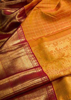 Kanjivaram Sarees: The Kanjivaram sari (which derives its name from the famous temple town of Kanchipuram, 90 km south west of Chennai) is one of the finest silk saris of India. Due to the strong patronage of the Chola Dynasty, the Tanjore District emerged as amongst the largest traditional silk weaving clusters of South India and likewise due to the patronage of the Pallava Dynasty, silk weaving assumed importance in the ancient Pallava Capital of Kanchipuram. #AngadiSilks #SilkSarees