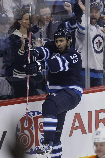 Winnipeg's Dustin Byfuglien, celebrating a goal, has a shot to be a member of the U.S. Olympic team. Description from denverpost.com. I searched for this on bing.com/images