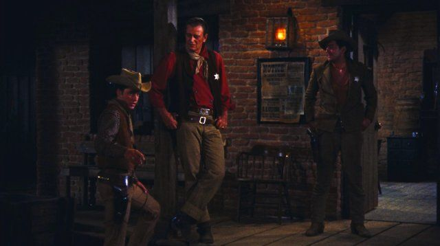 © 1959 - Warner Bros. All rights reserved. Titles: Rio Bravo Names: John Wayne, Dean Martin, Ricky Nelson Still of John Wayne, Dean Martin and Ricky Nelson in Rio Bravo