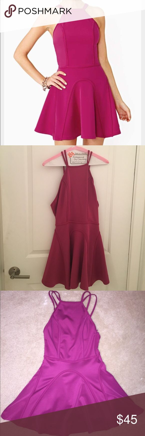 Nasty Gal Fuchsia Circle Skater Dress Size M Nasty Gal Fuchsia Circle Skater Dress Size M. SO ADORABLE. Freshly dry cleaned, no signs of damage/wear. Worn once to an event. Zipper and zipper clasp are intact. I would keep but it's super short (I'm 5'9). Mini style, high neck with cool straps on the back. Lining detailed on back and front for flattering flare. I paired with nude pumps and a multi color clutch for a night out. Nasty Gal Dresses Mini