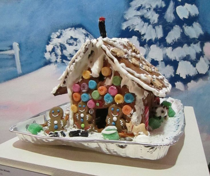"Adult Division - ""The House in the Woods."" Materials used: pretzels, Twizzlers, chocolate bars, and coconut flakes. (2013 entry): Houses Exhibitions, Gingerbread Houses"