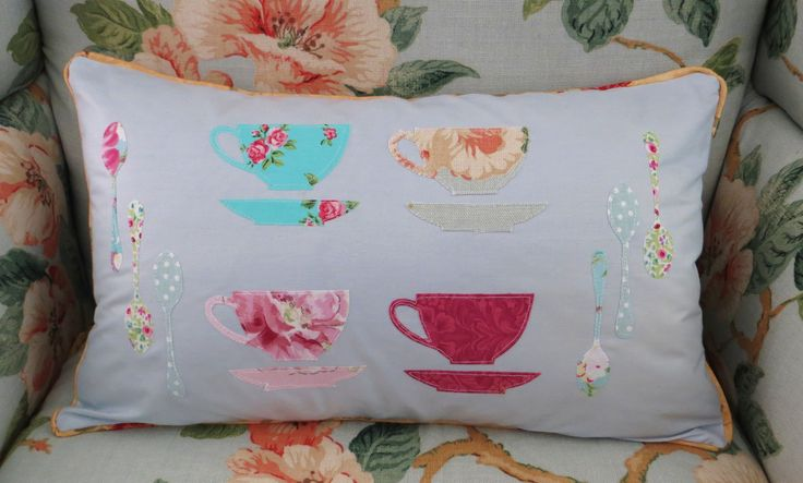Applique cushion cover with teacups and teaspoons