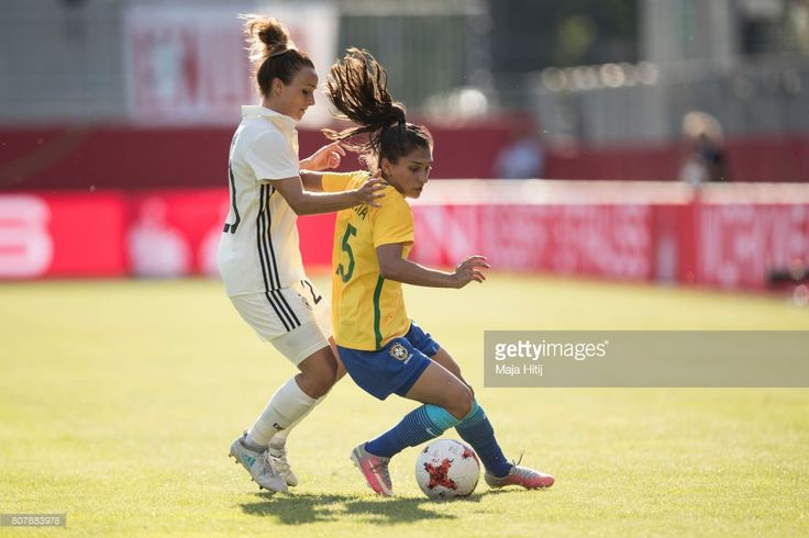 Lina Magull of Germany and Leticia Santos (R) of Brazil battle for the ball during the Women's International Friendly match between Germany and Brazil at BWT-Stadion am Hardtwald on July 4, 2017 in Sandhausen, Germany.
