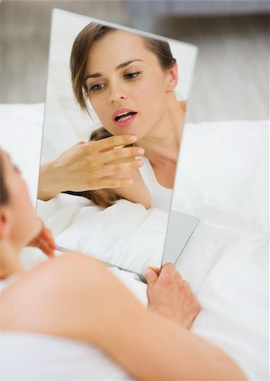 Acne and hair growth can be symptoms of polycystic ovary syndrome (PCOS). They can also be associated with irregular periods and ovarian cysts