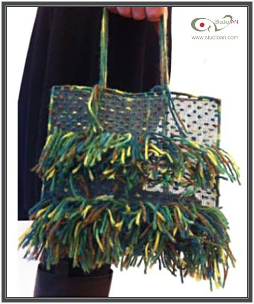 Soft screen handbag with multi coloured knitting wool #studioAN #handbags #transparentbags #handmade http://www.studioan.com/ngine/en/product/80/soft-screen-handbag-with-multi-coloured-knitting-wool