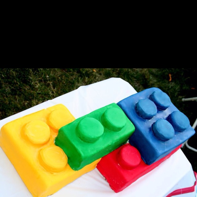 """Giant Lego Cake made without Lego Molds. Just use regular pans & the round """"connector"""" pieces are made by making a sheet cake & then using a round cookie cutter. Then covered in colored fondant."""
