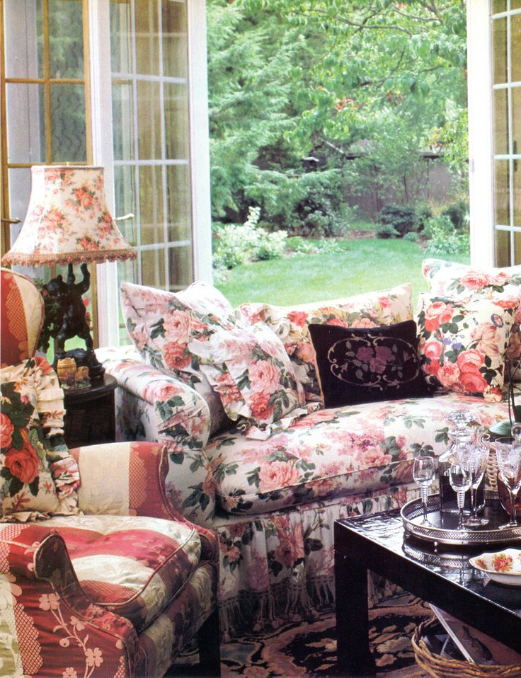 Lovely view out the window, with pretty chintz fabric furniture.