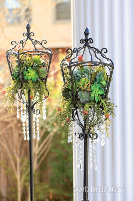 Get green scene ambiance at light speed with a succulent-filled lantern. For this look, we used raffia to anchor a ball of floral foam to the metal. Then we tucked in a variety of stems, along with bits of made-to-dangle greenery. To finish, we added diamond picks and hanging gems.