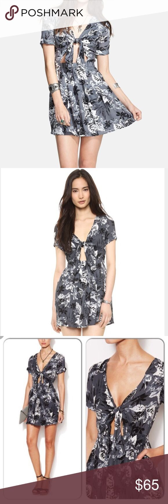 Free people floral front tie dress Cute free people floral mini dress. In perfect condition. Message me for any questions or more information. I'm accepting offers on this item Free People Dresses Mini