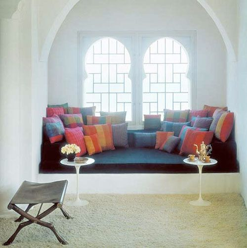 love the shaped windows, arch over top, deep window seat, white walls and colour accessories