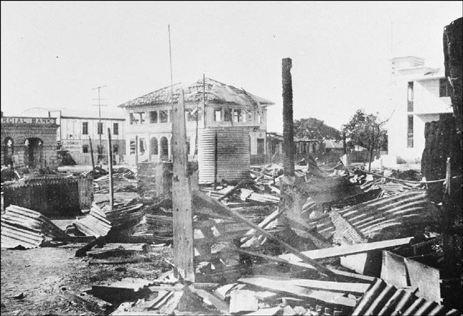 city in ruins after a 1942 Japanese air raid on Darwin - Northern Territory. The first attack on Darwin was led by the same Japanese Commander responsible for the attack on Pearl Harbour ten weeks earlier.