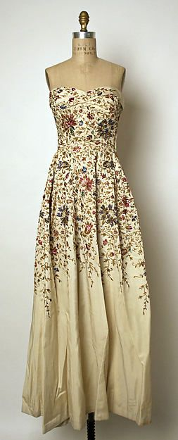 Evening dress Design House: House of Balmain (French, founded 1945) Designer: Pierre Balmain (French, St. Jean de Maurienne 1914–1982 Paris) Date: 1953 Culture: French Medium: silk, nylon, metallic embroidery, sequins Dimensions: Length at CB: 51 in. (129.5 cm) Credit Line: Gift of Jean Sinclair Tailer, 1964 Accession Number: C.I.64.13.2