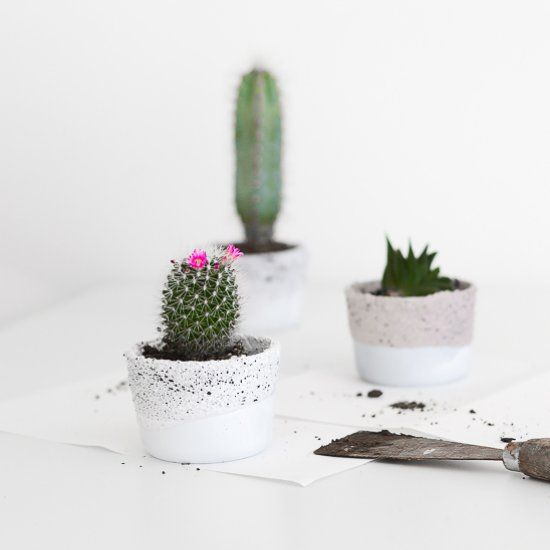 Ikea hack: How to transform small glass containers into this cute set of planters, with a splatter pattern.