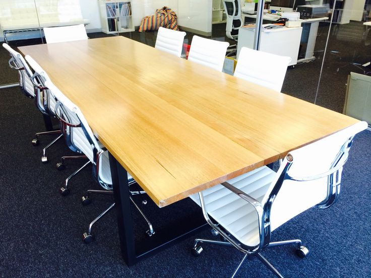 One very large boardroom table for Spencer this is thick slabs of solid hardwood and custom made steel box frame legs