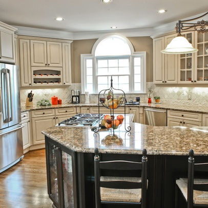 Cream cabinets, black island, St. Cecelia granite