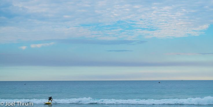 L1M1AS3-Landscapes ISO 280 55mm f/8.0 1/250 sec nikkon d5500 Taken at manly a dusk. Tried to catch the paddle boarder as the went don't the wave.