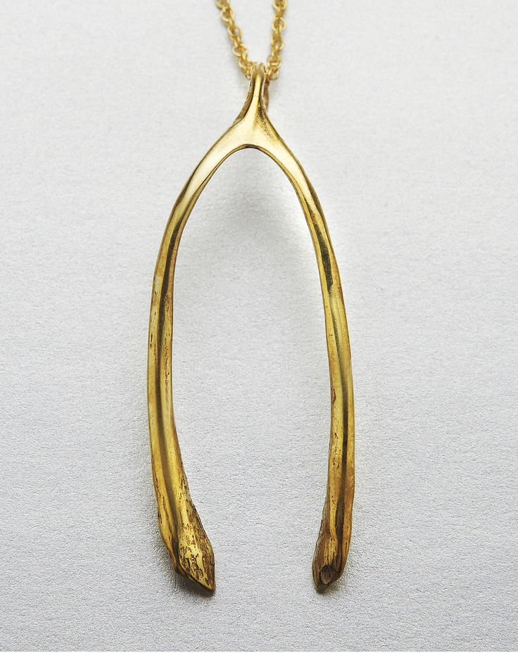 "Wishbone pendant necklace in gold brass from Verameat. Designer: VERAMEAT Dimensions: 24"" chain Material: Brass Origin: USA Why we Covet: One part irreverent; one part rock 'n' roll"