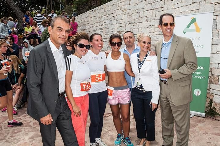 The Astir Palace Ladies Running team, with Mr. Michael Metaxas, Mr. Markos Lambiris, Mr. Andreas Lagaris and Mrs. Irini Zambelaki.
