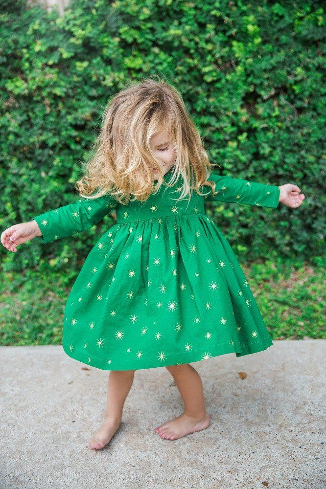 Holly Dress, in green cotton with gold stars. Shop Christmas dresses for little girls and all holiday Dresses 2016 for kids, from cuteheads.