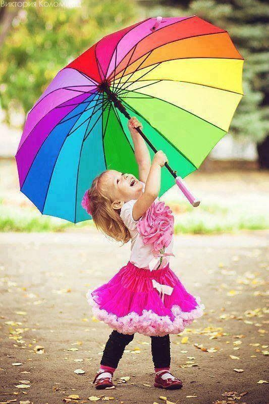 ...little girls smile w rainbow umbrella  priceless picture