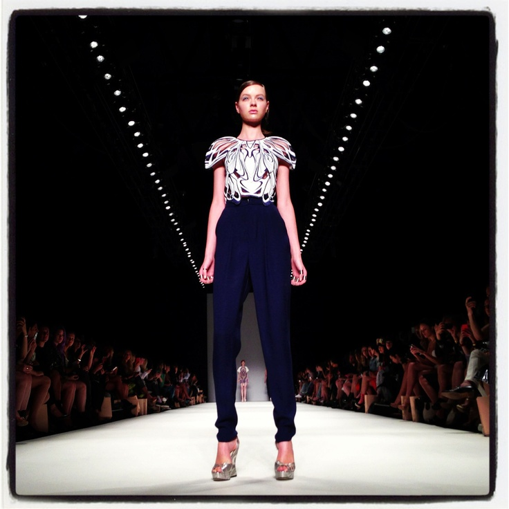 A model showcases designs on the runway at the Alice McCall show during Mercedes-Benz Fashion Week Australia.