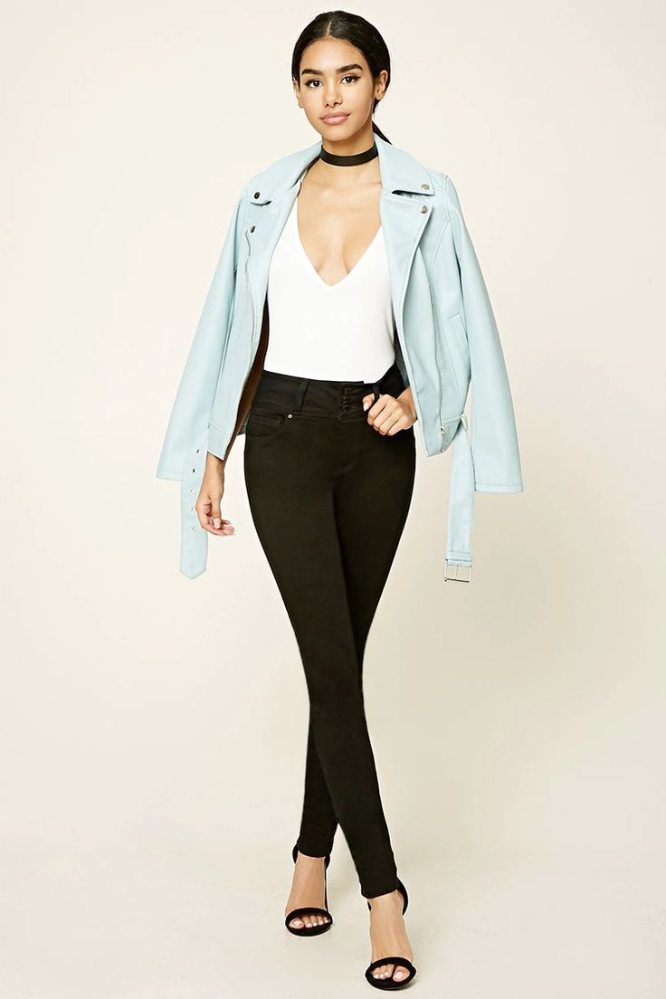 A pair of skinny jeans featuring a triple button high-waist, zip fly, and five-pocket construction.