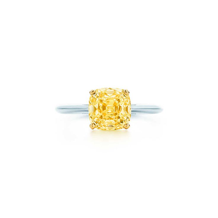 I love the simplicity! Ring in platinum with a square antique modified brilliant yellow diamond.   Tiffany & Co.