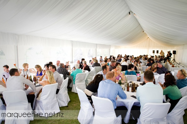 This beautiful wedding chose to go with grass flooring, and it was a great way to connect the guests to the natural setting outside as well as keeping costs down
