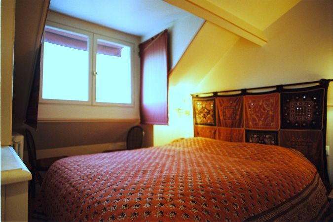 Romantic bedroom in eve Paris apartment