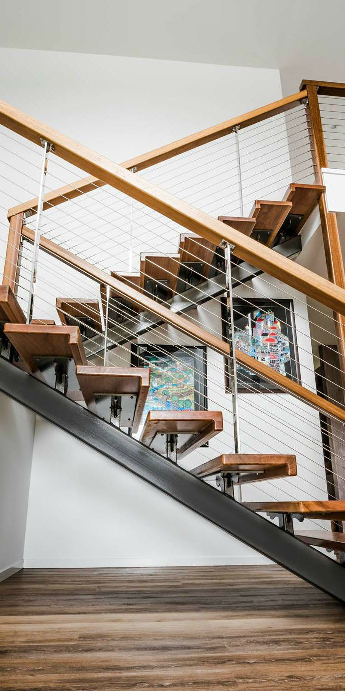 A beautiful staircase by One Sector Constructions Pty Ltd. Using Miami Stainless swivel joiners, the Insert Swage Stud Balustrade System, 1x19 3.2mm wire and custom made mirror polished intermediate posts. Want to know more about the products in this project or need help with your next project call our team on 1800 022 122.