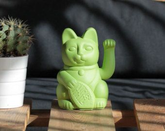 "Lucky Cat ""Gatete"" Is the stylish version of the classic lucky cat handpainted in green pistachio colour 10.5x9.5x17.5 cm"