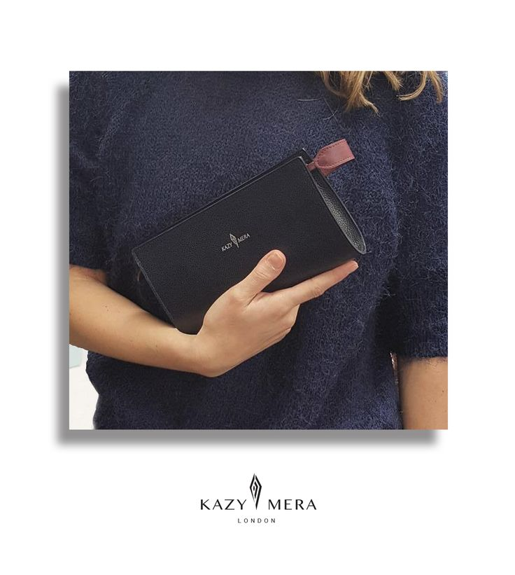 Navy Leather Pouch with unique closure.
