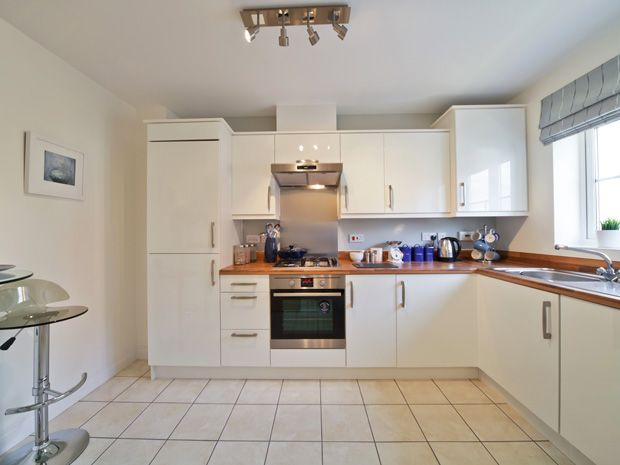 This smart and simple kitchen is ideal for first time buyers: http://bit.ly/1vyHPir