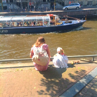 Mother and daughter chatting with a man in a boat....