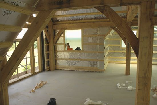 Internal view of the WrightWall Natural encapsulation system wrapped around the oak frame.