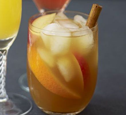 500ml Pimm's   500ml brandy   1½ l apple juice   ice   2 cinnamon sticks   apple , sliced   orange , sliced