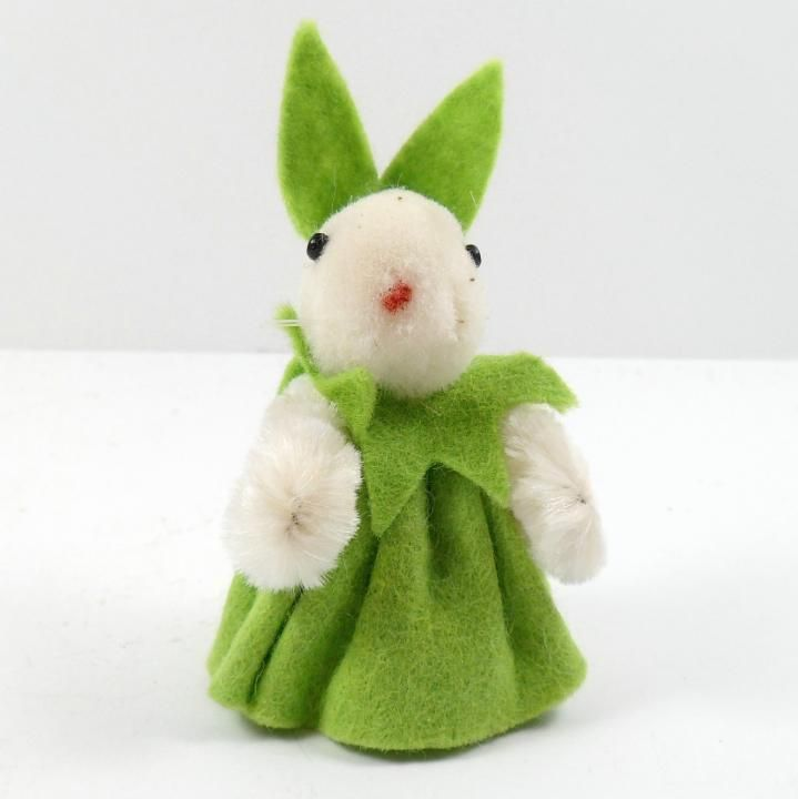 Offered is a miniature girl bunny rabbit with a wool body that's dressed in a green felt dress with green felt ears. Her arms are white wired chenille so you can move them a little. The base is marked Wollminiaturen Hand Made in W. Germany Model ...