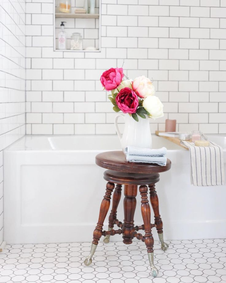I sat on this old piano stool as a girl and its charm never seems to fade on me. This and a few other shots of our bathroom were recently featured in an article on @wayfair It's fun to share the story of our home with others.  PS- I heart flowers.