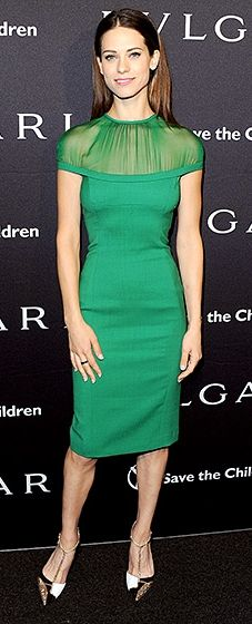 The Agent Carter star sported an emerald cocktail dress with a sheer neckline. She paired the sleek look with black and white pointy-toe pumps.
